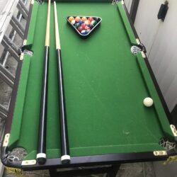 Portable folding pool table